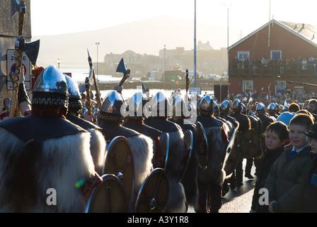 dh Up Helly Aa procession LERWICK SHETLAND Guizer Jarl Einar of Gullberuviks Viking sqaud parading crowds watching - Stock Photo