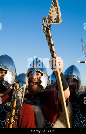 dh Up Helly Aa procession LERWICK SHETLAND Guizer Jarl Einar of Gullberuviks Viking cheering with axe - Stock Photo