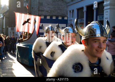 dh Up Helly Aa procession LERWICK SHETLAND Cheering Junior Guizer Jarl squad parading Viking longship galley kids - Stock Photo