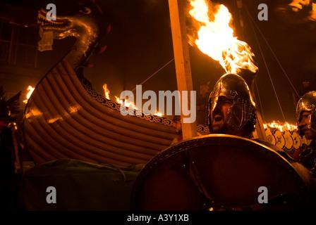 dh Up Helly Aa fire procession LERWICK SHETLAND January Vikings Viking longship galley squad festival parade - Stock Photo