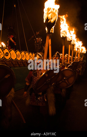 dh Up Helly Aa fire procession LERWICK SHETLAND Vikings Scotland Viking longship galley squad torches parade warriors - Stock Photo