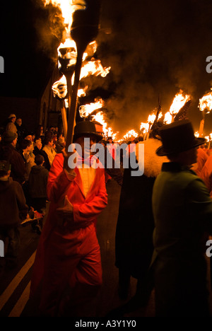 dh Up Helly Aa fire procession LERWICK SHETLAND Guizers with torches following Viking parade people festival - Stock Photo