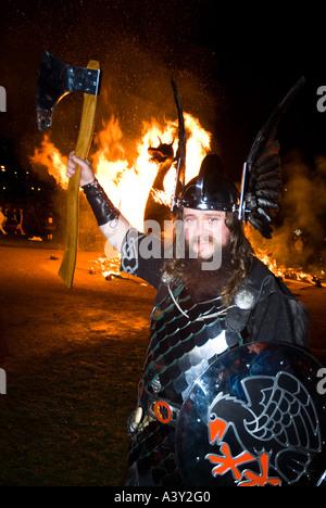 dh Up Helly Aa fire procession LERWICK SHETLAND Guizer Jarl Einar of Gullberuvik Viking longship galley Moogi alight - Stock Photo