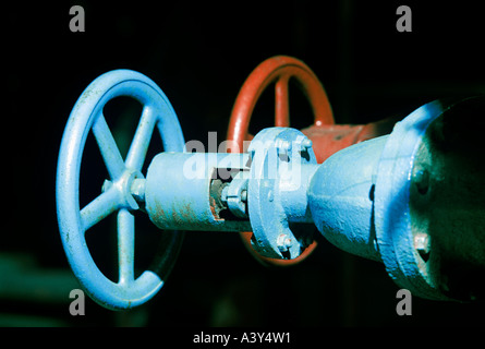 shutoff valves and flow controllers in water supply plant - Stock Photo