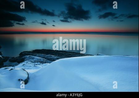 Coastal winter landscape after dark at Larkollen in Rygge kommune, Østfold fylke, Norway. - Stock Photo