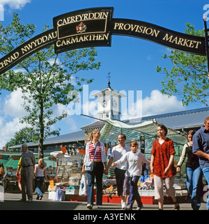 Carmarthen Market entrance and shoppers in rural West Wales, UK - Stock Photo
