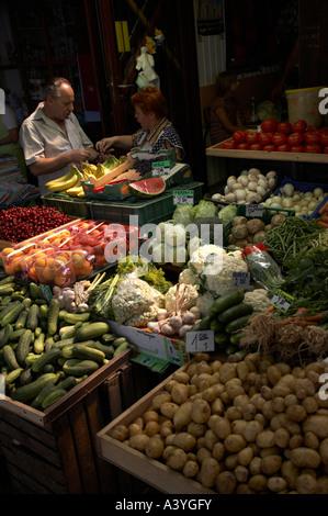 Market stalls selling fresh fruit and vegetables - Stock Photo