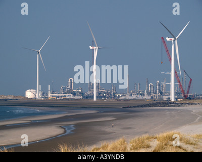 Wind turbines being built constructed on the Maasvlakte beach near the port of Rotterdam the Netherlands - Stock Photo