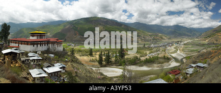Ultra wide angle view of Paro Valley and Dzong in the Kingdom of Bhutan - Stock Photo