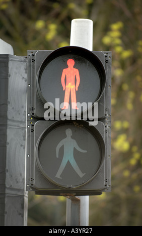 An illuminated red man pedestrian stop sign at a pelican crossing. - Stock Photo