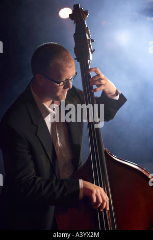 Double bass player on stage, portrait - Stock Photo