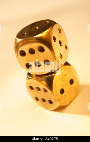 TWO ANTIQUE POLISHED GOLD BRASS DICE - Stock Photo