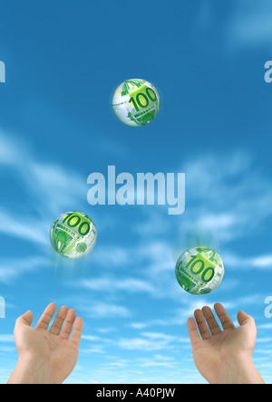 Juggler with Euros Euro Jongleur - Stock Photo