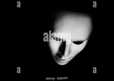 Costume mask photographed in moody lighting - Stock Photo