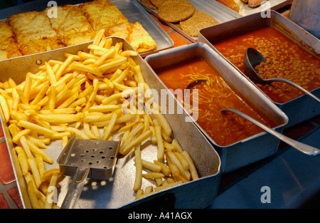 School dinners on hot counter waiting to be served in school refectory UK - Stock Photo