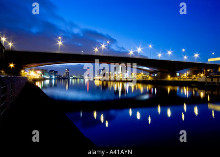 A view of Glasgow by night from looking west towards the Kingston Bridge and along the River Clyde - Stock Photo