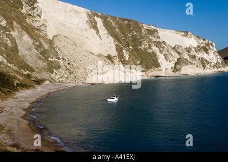 Single boat moored in beautiful Mupe Bay, Dorset. - Stock Photo