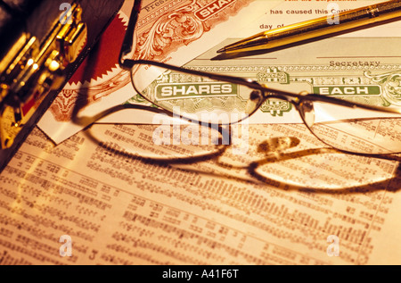 [stock certificates] and [stock prices] - Stock Photo