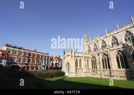 Saint Marys Parish Church and grounds looking towards the Georgian facade of the Beverley Arms Hotel Beverley Yorkshire - Stock Photo