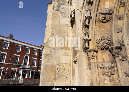 Architectural detail of Saint Marys with the Georgian facade of The Beverley Arms Hotel in the background Beverley - Stock Photo
