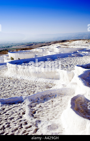 Dry travertine pools in the hillside at Pamukkale Turkey - Stock Photo