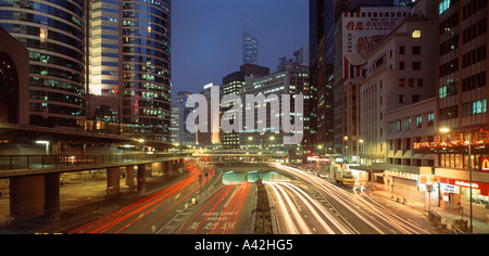 China Hongkong central skyscaper traffic lights on main street downtown business district background bank of china - Stock Photo