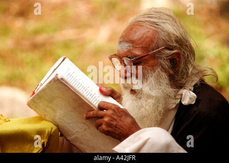 Brahmin studying the mantras at his maditation hideout in Rishikesh, Uttranchal India - Stock Photo