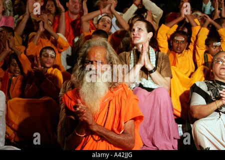 Priest holding the Aarti rituals at the banks of Ganga in Rishikesh, Uttranchal India - Stock Photo