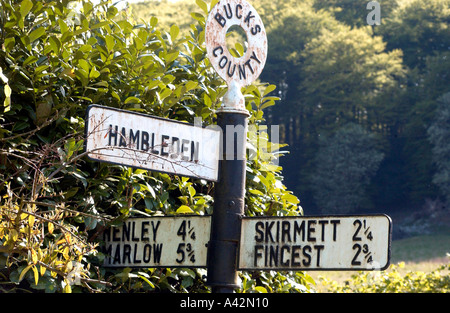 Sign pointing along a country lane in Buckinghamshire towards Hambleden village. - Stock Photo