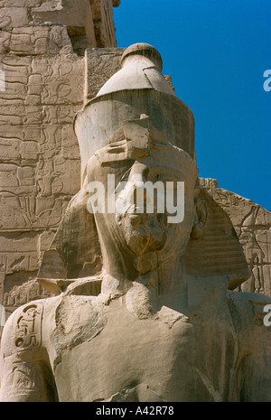 Even though damaged this head of a colossal statue of Ramses ll at the temple at Luxor Egypt is noble and beautiful - Stock Photo