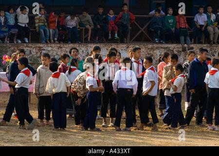 Children in the Schoolyard Luang Prabang Laos - Stock Photo