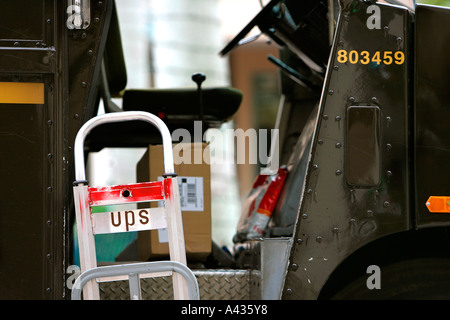 UPS bus car vehicle transport mailbox letterbox postbox postal correspondence shipping delivery red flag metal residential - Stock Photo