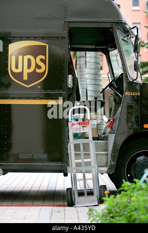 UPS bus car vehicle transport firehydrant mailbox letterbox postbox postal correspondence shipping delivery red - Stock Photo