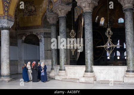 Muslim women visiting Hagia Sophia, Istanbul Turkey. - Stock Photo