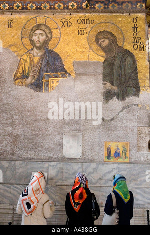 Muslim women looking at ikonas in Hagia Sophia, Istanbul Turkey. - Stock Photo