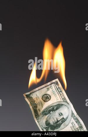 Burning One Hundred Dollar Bill - Stock Photo