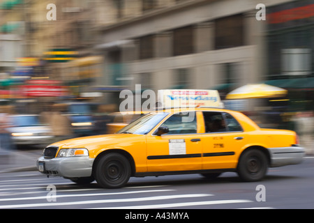 Rushing Taxi Cab in New York City - Stock Photo