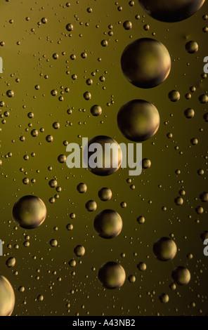 Water droplets reflecting fall color hues - Stock Photo