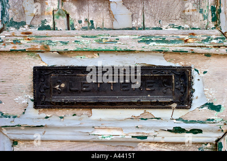 private home blue azur box letter on a old wooden door with letter inside in greece village - Stock Photo