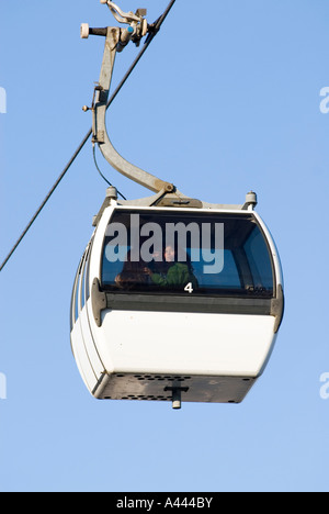 Woman enjoying the view of PARQUE DAS NACOES or Park of Nations from a cable-car ride TELEFERICO in Lisbon Portugal - Stock Photo