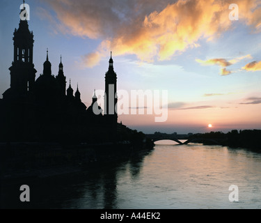 ES - SARAGOSSA:  Sunset over the Basilica of our Lady of El Pilar and Rio Ebro - Stock Photo