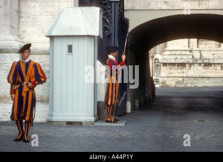 Two Members Of The Swiss Guard,On Duty Within The Catholic State Of Vatican City.In The  Heart Of Rome. - Stock Photo