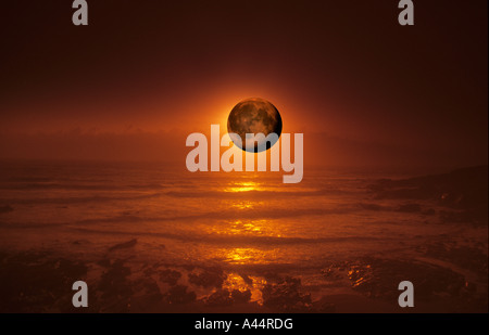 Sunset & Moonrise Over The Atlantic Ocean,Taken In Newquay Cornwall UK. - Stock Photo