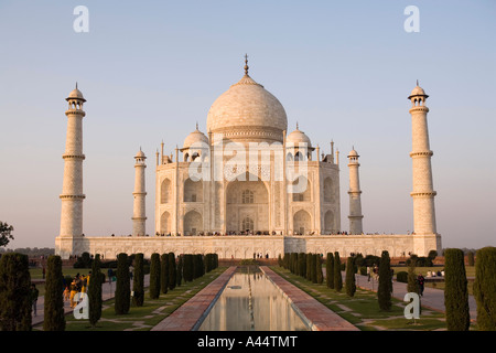 India Uttar Pradesh Agra Taj Mahal late afternoon front elevation reflected in pool - Stock Photo