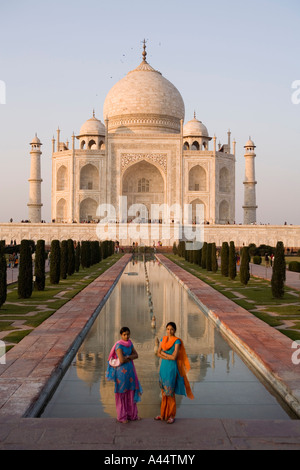 India Uttar Pradesh Agra Taj Mahal colourfully dressed Indians posing for picture in late afternoon - Stock Photo