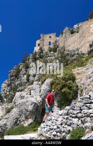 Tourist climbing the steps up to Buffavento Castle in the Besparmak mountains, North Cyprus - Stock Photo