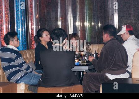 Chinese Young People Sitting Having Fun In Nightclub Taipei Taiwan China - Stock Photo