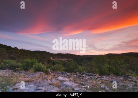 Susnet with colorful clouds over the Hill Country in Texas, USA - Stock Photo