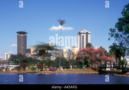 Nairobi city skyline seen from the boating lake in Uhuru Park Kenya East Africa - Stock Photo
