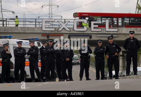 police line up as peace protesters march against the largest arms fair in europe the defence systems and equipment - Stock Photo